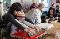Seattle, Washington: Beth Anderson demonstrates proper screen printing technique in the print studio. Supporters turned out in droves at the Screen Pr...