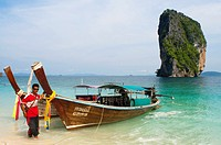 Long-tail boat moored on the beach at Koh Poda Islands in the Andaman Sea, Thailand. Ko Poda is an island off the west coast of Thailand, in Krabi Pro...