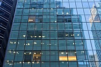 Manhattan, New York City. Looking Up at Office Buildings Being Reflected in the Glass Facade of Another High-Rise Office Building.