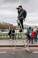 A Photographer Stands On A Step Ladder To Take Photographs Of People On Westminster Bridge A Week After The Terror Attack, London, UK.