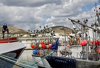 A boat sview with a sailor in the Carboneras port, Almería province, Spain.
