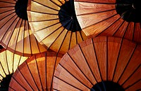 Rice-paper umbrellas for sale at the evening market in the former royal capital of Luang Prabang, Laos.