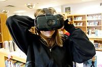 7th Grade Girl Wearing Virtual Reality Glasses, Wellsville, New York, USA.