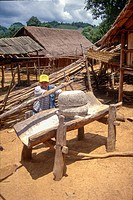 War-time mortar used to husk rice in a Hmong village on the Plain of Jars, Xieng Khouang Province, Laos.