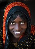 Portrait of a smiling Afar tribe teenage girl with braided hair, Afar region, Mile, Ethiopia.