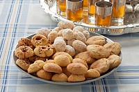 Traditional variety of festive Moroccan cookies and mint tea.