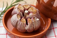 Roasted garlic in a ceramic bowl.