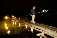 Professional fisherman of lamprey. Estacadas, Wooden bridges for the lamprey fishing. Primitive system of fishing that is practiced only in the Tea an...