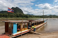 Tourists disembarking an excursion boat at the Pak Ou Cave on the Mekong River near Luang Prabang in Central Laos.