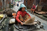 Winnowing grain in the streets of Bungamati, Kathmandu Valley, Nepal.