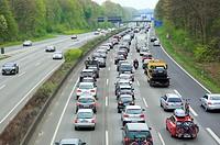 road traffic, motorway, traffic jam on the A2 at the Oberhausen motorway junction, Kreuz Oberhausen, automobiles, cars, motorcars, trucks, lorries, Ob...