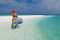 Female Tourist on Sand Bank, Felidhu Atoll, Maldives.