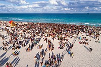 Florida, Miami Beach, Atlantic Ocean, Spring Break, college university, Black, teen, boy, girl, student, crowd, aerial overhead view,