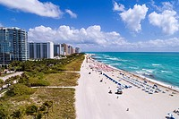 Florida, Miami Beach, sand, Atlantic Ocean, surf, overhead aerial view, lounge chairs, cabanas, high rise condominium buildings, hotels,