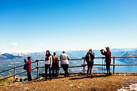 Tourists admire landscape from the top of Mottarone, Stresa, Italy.