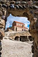 10th century Christian Prince's basilica viewed through rock arch, Uplistsikhe cave city known as Lord's fortress, Gori, Shida Kartli district, Georgi...