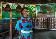 Ethiopian woman inside her traditional painted and decorated house, Kembata, Alaba Kuito, Ethiopia.
