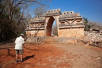 Visitors near the Labna Arch in the Labna Archaeological site, Puuc Route, Merida, Yucatan State, Mexico, Central America.