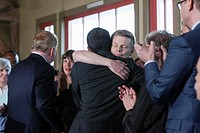 Seattle, Washington: Mayor Ed Murrayâ. . s husband Michael Shiosaki embraces congresman Jamie Pedersen at a press conference withdrawing from the race...