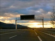 Highway at dusk. Segovia province, Castilla Leon, Spain.