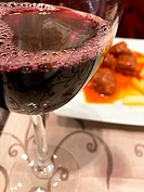 Glass of red wine in a restaurant. Close view.