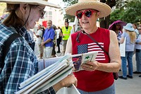 Tucson, Arizona - A woman circulates a petition supporting pre-school programs for kids.