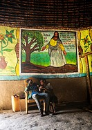 Ethiopian children inside their traditional house with decorated and painted walls, Kembata, Alaba Kuito, Ethiopia.