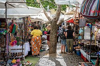 Shoppers are browsing handmade items at an open market in downtown Cape Town, South Africa.