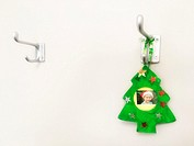 Christmas memorabilia on a coat hanger.