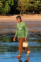 Man at sunset with the low tide looking molluscs in Happy Island, Hat Phra Nang Beach, Railay, Krabi Province, Thailand, Southeast Asia, Asia. Hat Phr...