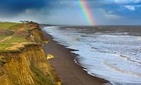 Rainbow off Weybourne Norfolk in rain storm.