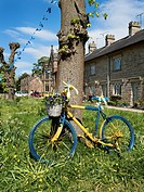 Yellow and Blue Painted Bicycle Marking the Tour de Yorkshire at Ripley North Yorkshire England.