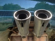 Double exhaust pipes from a car. Underside view.