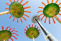 Seattle, Washington: The Space Needle framed by artist Dan Corsonâ. . s monumental floral sculptures â. œSonic Boomâ. . during the Northwest Folklife ...