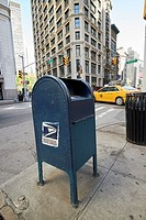 united states postal service blue dropbox post box New York City USA.