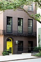 New York City, Manhattan. Upper East Side Town House with a Bright Yellow Door.