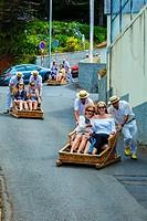 Toboggan ride going down Monte, Funchal. Madeira, Portugal, Europe.