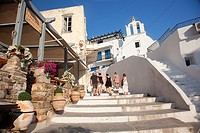Tourists walking up the stairs of the old town Chora with a chapel at the background, Naxos, Cyclades Islands, Greek Islands, Greece, Europe.