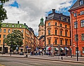 Old town Stockholm with the clock tower of the Church of St. Nicholas (Sankt Nikolai kyrka) also known as Storkyrkan (The Great Church) and Stockholms...