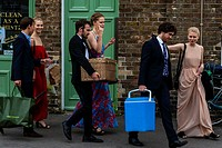Young opera fans with their picnic baskets arrive at Lewes railway station enroute to Glyndebourne Opera House to see a performance of Ariadne auf Nax...