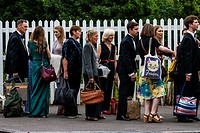 Opera fans with their picnic baskets arrive at Lewes railway station enroute to Glyndebourne Opera House to see a performance of Ariadne auf Naxos, Le...
