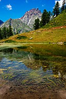 Alpine lake and mountain landscape, Alpe Devero, Italy.