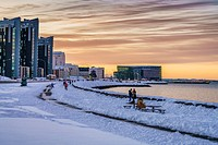 Walking path along the sea in the wintertime, Harpa in the backgrounsd Reykjavik, Iceland.