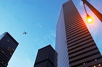 Seattle, Washington State, USA - Plane flying above city's skyscrapers