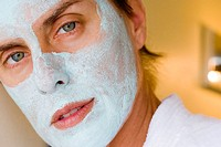Woman with green facial mask