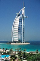 The 7 star luxury Burj al Arab Hotel seen from the grounds of the 5 Star luxury Jumeirah Beach Resort Hotel at Jumeirah Beach, Dubai, United Arab Emir...