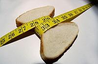 Piece of bread measuring waistline