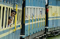 Loughing girls looking out of the train windows of the Nilgiri Mountain Railway driving from Coonoor to Ooty. Tamil Nadu, India 2005.  - Info: The Nil...