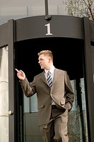 Businessman leaving office, outdoors