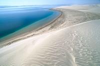 Dunes and sea. Khor Al Adaid. Qatar.